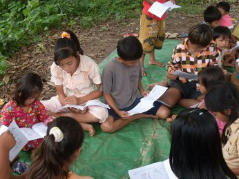 Koch Dach, Cambodia - chidlren enjoying the Manna for Children coloring books