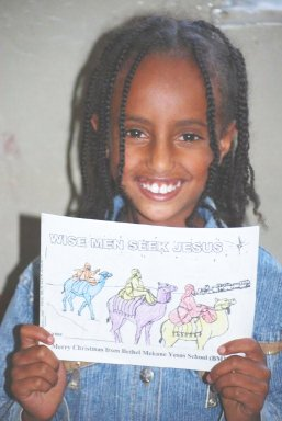 a girl showing off her read-and-color book.