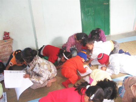 coloring in a huddle on the floor